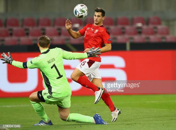 Remo Freuler of Switzerland scores his team's second goal past Manuel Neuer of Germany during the UEFA Nations League group stage match between...