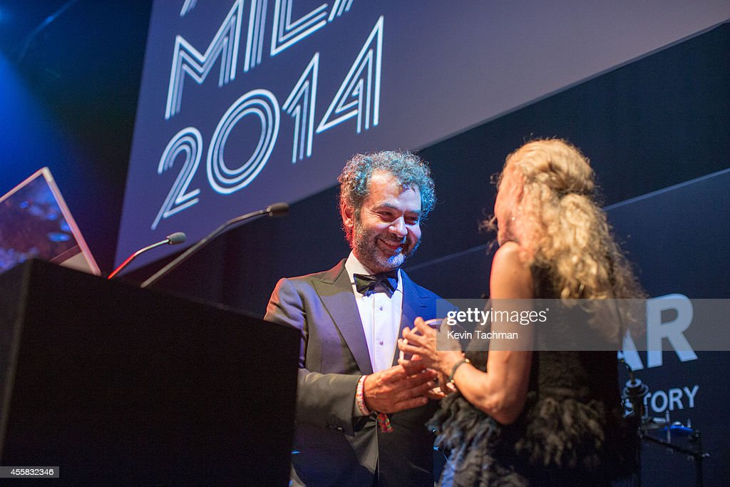 Remo Ruffini and Franca Sozzani appear on stage during the amfAR Milano 2014 - Gala Dinner and Auction as part of Milan Fashion Week Womenswear Spring/Summer 2015 on September 20, 2014 in Milan, Italy.