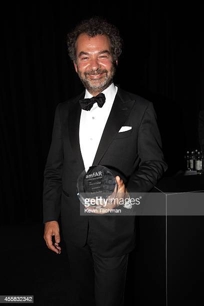 Remo Ruffini walks off stage during the amfAR Milano 2014 Gala Dinner and Auction as part of Milan Fashion Week Womenswear Spring/Summer 2015 on...
