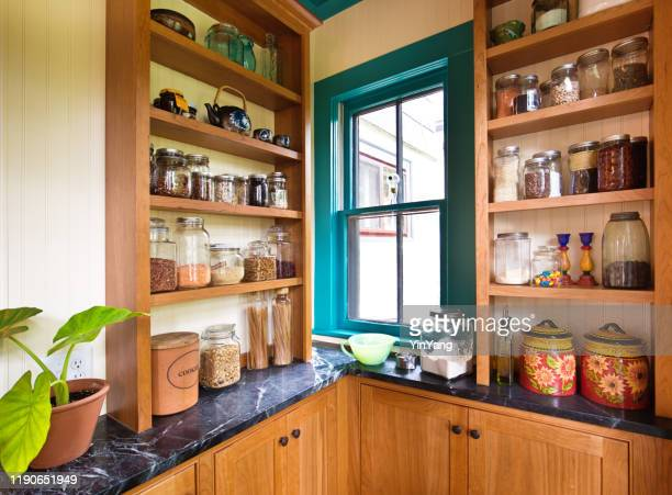 remodeled contemporary classic kitchen design with pantry storage - food pantry stock pictures, royalty-free photos & images