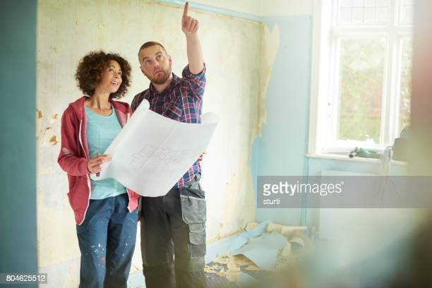 remodelling their home - reform stock pictures, royalty-free photos & images