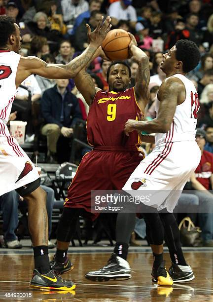 Remon Nelson from the Canton Charge tries to escape the double team of Anthony Mason Jr. #22 and Larry Drew II from the Sioux Falls Skyforce in the...