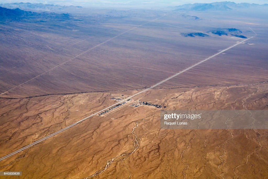 Remote airstrip and tiny town in the desert. : Stock Photo