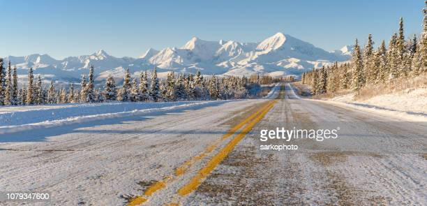 Remote Alaska Highway With Winter Mountain Panorama
