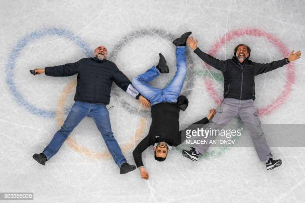 Remote camera picture, showing AFP Photographers Mladen Antonov, Aris Messinis and Roberto Schmidt posing on the ice after the figure skating event...