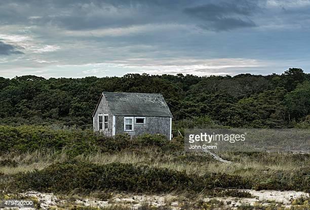 S VINEYARD AQUINNAH MASSACHUSETTS UNITED STATES A remote coastal cottage weathered by wind and sea salt