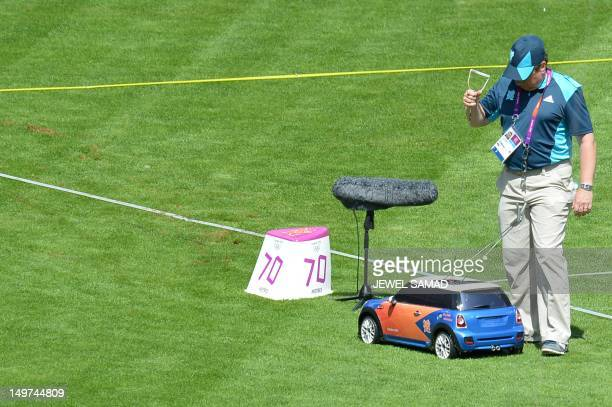 A remote control car brings back a hammer during the men's hammer throw qualifying rounds at the athletics event during the London 2012 Olympic Games...