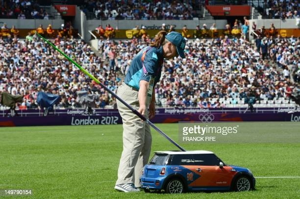 Remote control car brings back a javelin during the women's heptathlon javelin throw qualifications at the athletics event of the London 2012 Olympic...