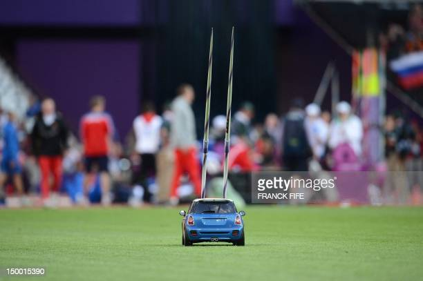Remote control car brings back javelins during the men's javelin throw qualifications at the athletics event of the London 2012 Olympic Games on...