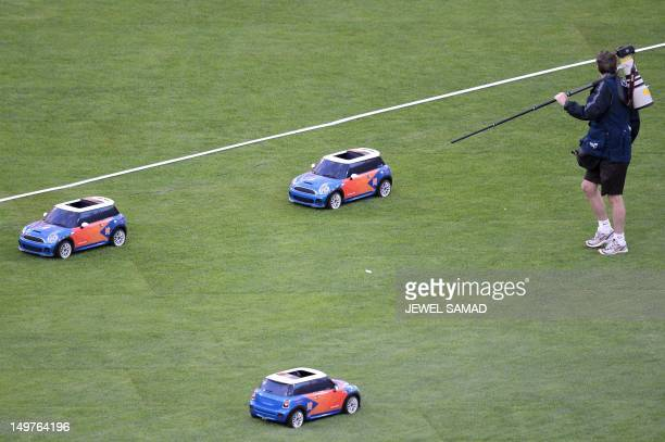 Remote control car brings back shots during the women's heptathlon shot put at the athletics event during the London 2012 Olympic Games on August 3...