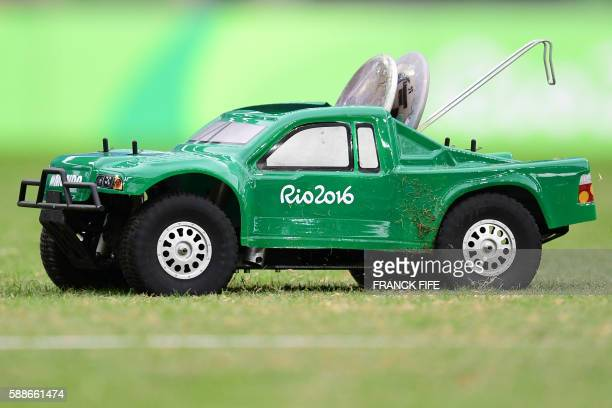 A remote control car carries discus in the Men's Discus Throw Qualifying Round during the athletics event at the Rio 2016 Olympic Games at the...