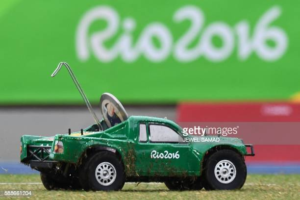 A remote control car carries the discus during the athletics events at the Rio 2016 Olympic Games at the Olympic Stadium in Rio de Janeiro on August...