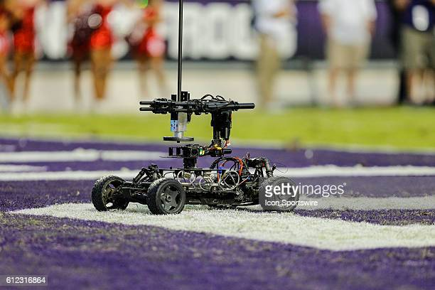 A remote control car carrying a 360 degree camera zips around in the end zone during the game between the TCU Horned Frogs and the Oklahoma Sooners...