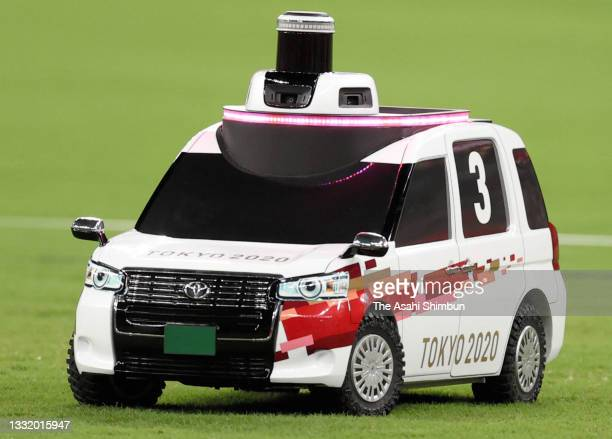 Remote control car carrying disc is in operation during the Men's Discus Throw final on day eight of the Tokyo 2020 Olympic Games at Olympic Stadium...