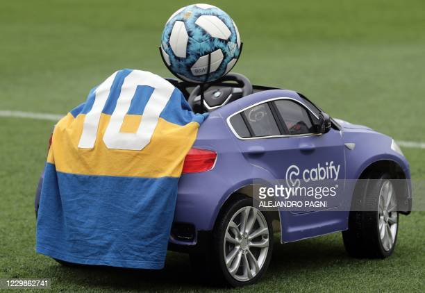 Remote control car covered with the Boca Juniors jersey with the number 10, to pay homage to late Argentinian football legend Diego Maradona, remains...