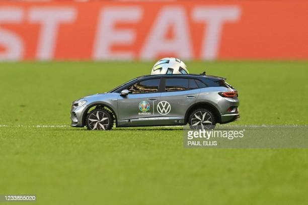Remote control car delivers the match ball for the UEFA EURO 2020 semi-final football match between England and Denmark at Wembley Stadium in London...