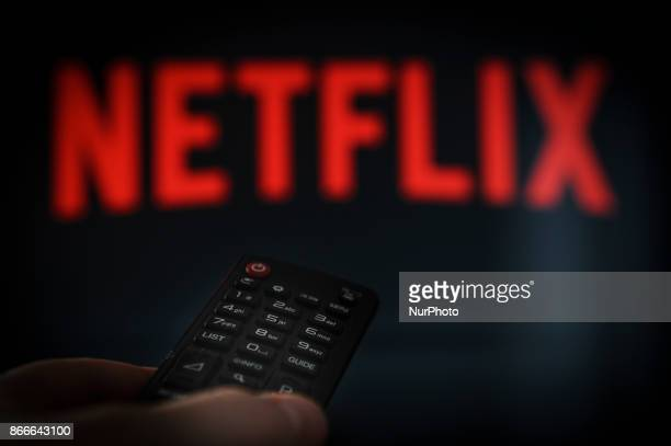 A remote control is seen being held in front of a television running the Netflix application on October 25 2017