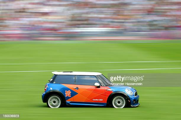 A remote control Mini car collects the discus on Day 13 of the London 2012 Olympic Games at Olympic Stadium on August 9 2012 in London England