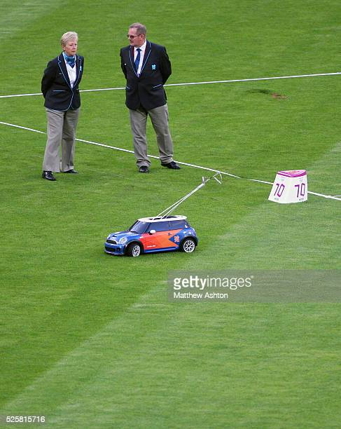 A remote control mini car collects the hammer from the pitch during the 2012 London Olympic Summer Games at the Olympic Stadium London UK on August...