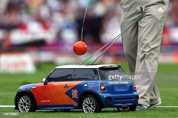 A remote control mini car is used to return the hammer in the Men's Hammer Throw on Day 7 of the London 2012 Olympic Games at Olympic Stadium on...