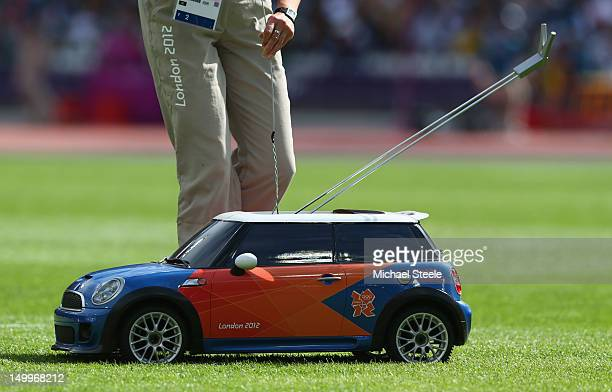 Remote control Mini car is used to return the hammer in the Women's Hammer Throw Qualifications on Day 12 of the London 2012 Olympic Games at Olympic...