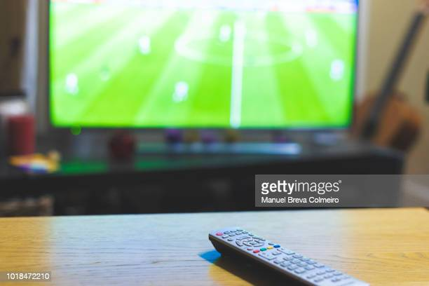 remote control over the table - television show stock pictures, royalty-free photos & images