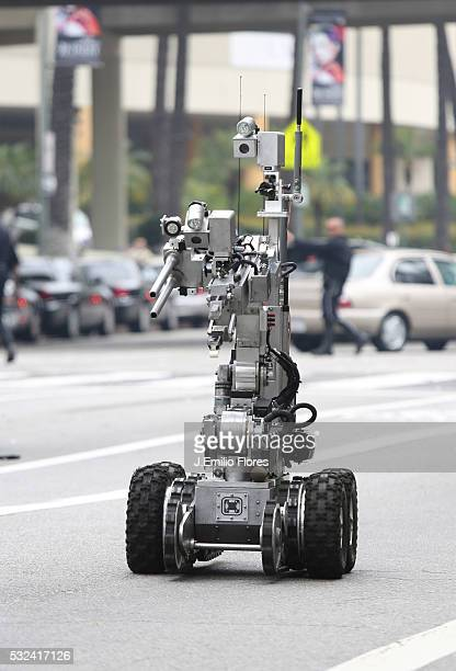 LOS ANGELES 060413 A remote control robot operated by the Los Angeles Police Department Bomb Squad removes a suicide vest from an Active shooter...