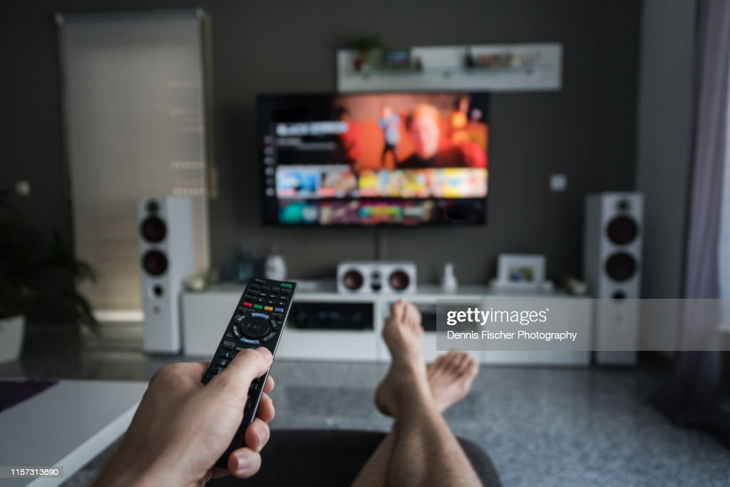 Remote Control with Television in living room : Stock Photo