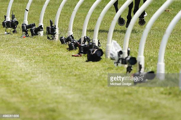Remote controlled still cameras ar seen at the finish line on Stakes Day at Flemington Racecourse on November 7 2015 in Melbourne Australia