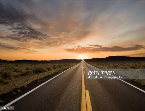 remote road at dusk - road stock pictures, royalty-free photos & images
