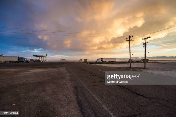 Remote truck stop in Utah salt flats with storm rolling in at Twilight