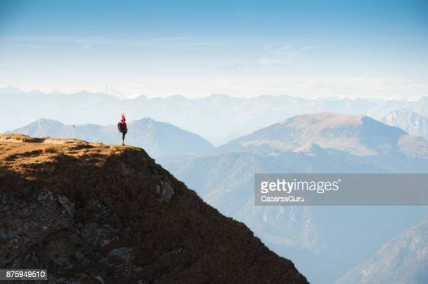 Remote View Of Woman Standing On The Top Of The Mountain With The Beautiful View Of Julian Alps