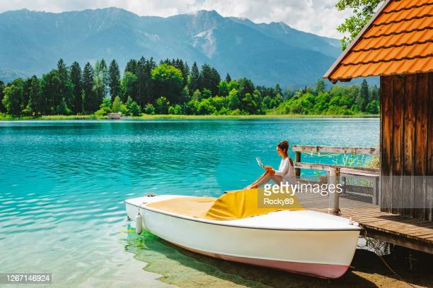 remote working and enjoying bleisure time at lake faak in austria - nomadic people stock pictures, royalty-free photos & images