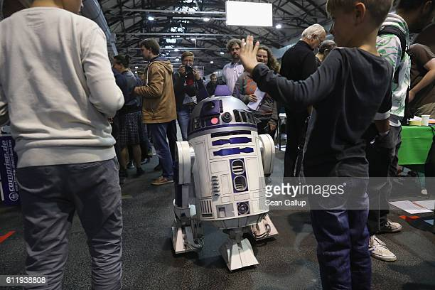 A remotecontrolled R2D2 robot wanders among visitors at the 2016 Berlin Maker Faire on October 1 2016 in Berlin Germany The Maker Faire combines a...
