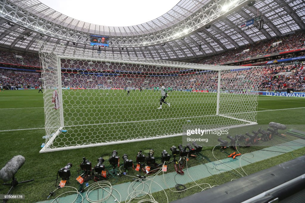 Remotely controlled cameras of the world's media sit behind a goal net ahead of the first match of the FIFA World Cup outside the Luzhniki stadium in Moscow, Russia, on Thursday, June 14, 2018. President Vladimir Putin has spent six years and more than $11 billion preparing nearly a dozen Russian cities to host the soccer World Cup, the biggest such event the countrys held since the collapse of the Soviet Union. Photographer: Andrey Rudakov/Bloomberg via Getty Images