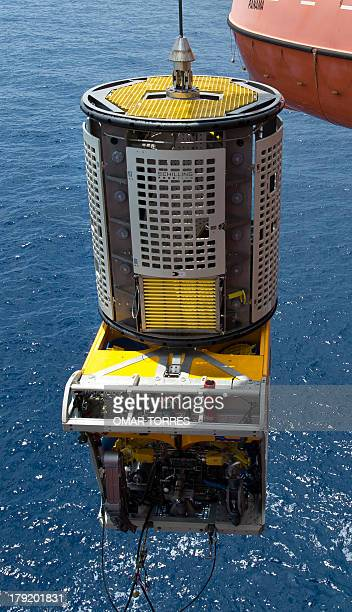 A remotely operated vehicle is being dunk into the sea at La Muralla IV exploration oil rig operated by Mexican company Grupo R and working for...