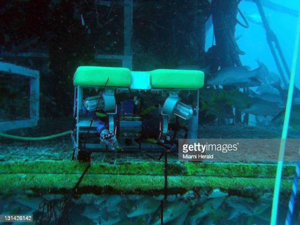 A remoteoperated vehicle is parked outside the Aquarius habitat in the waters off Key Largo Florida The program part of NASA Extreme Environment...