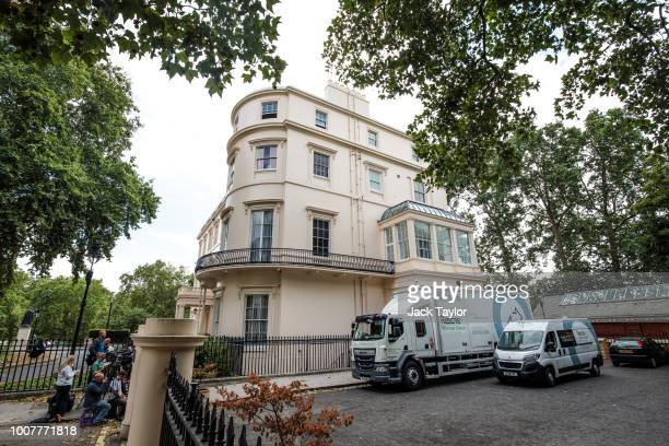 Removal men take out belongings from the Foreign Secretary's grace-and-favour residence in Carlton Gardens near Buckingham Palace as former Foreign...