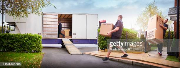 removal team loading removal truck - removal stock pictures, royalty-free photos & images