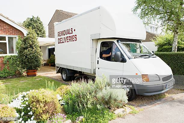 Removal van in driveway