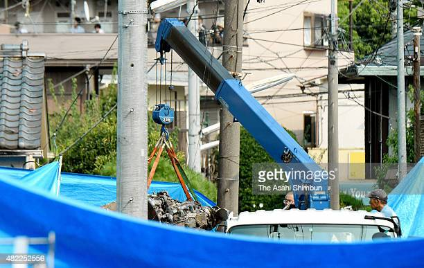 Removal work of the crashed airplane continues on July 29 2015 in Chofu Tokyo Japan