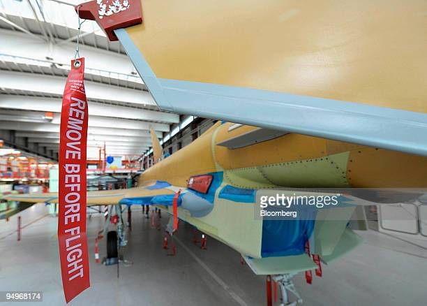 Remove before flight' safety tag hangs from a Eurofighter Typhoon aircraft, as it sits on the on the assembly line at the EADS factory in Manching,...