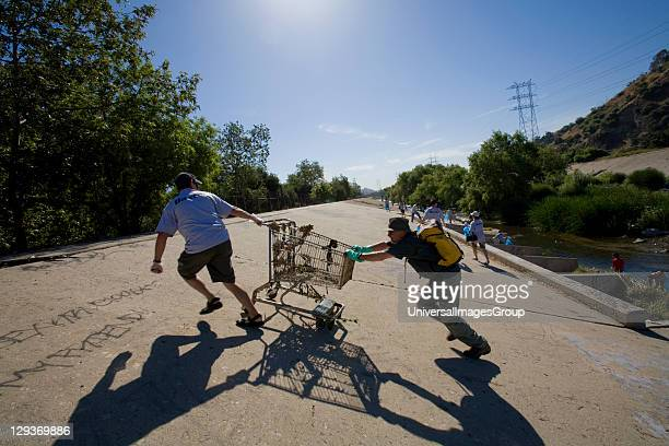Removing a shopping trolley from the Los Angeles River. FoLAR's annual 'La Gran Limpieza' clean up of the Los Angeles River. Bette Davis Picnic Area....