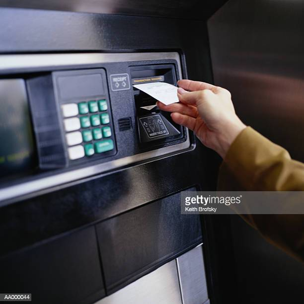 Removing a Transaction Slip from a Cash Machine
