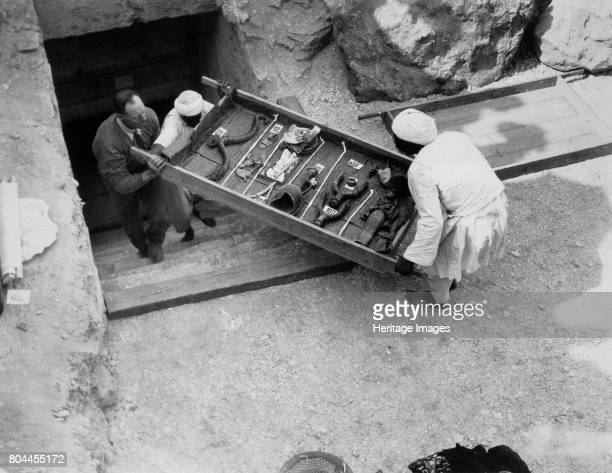 Removing a tray of chariot parts from the Tomb of Tutankhamun, Valley of the Kings, Egypt, 1922. The discovery of Tutankhamun's tomb in 1922 by...