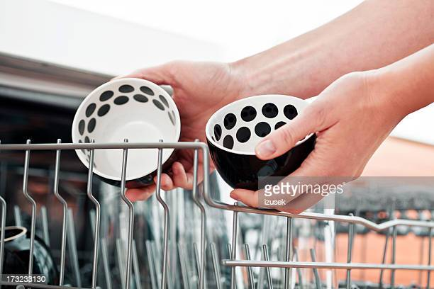 removing bowls from dishwasher - izusek stock photos and pictures
