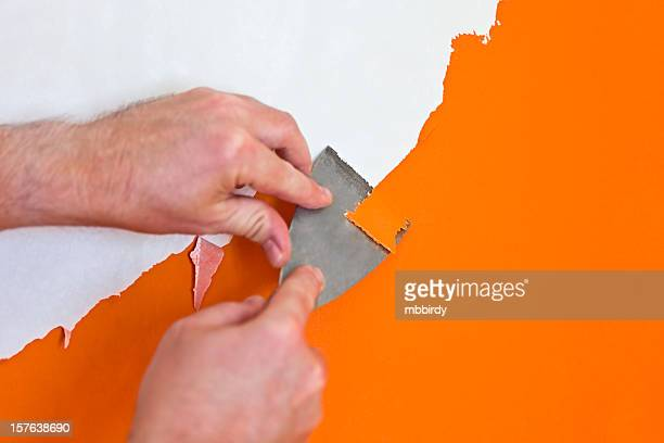 removing paint with putty knife - utility knife stock photos and pictures