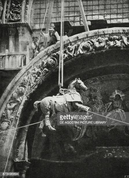 Removing the bronze horses from the facade of St Mark's Basilica Venice Italy World War I from L'Illustrazione Italiana Year XLIV No 41 October 14...