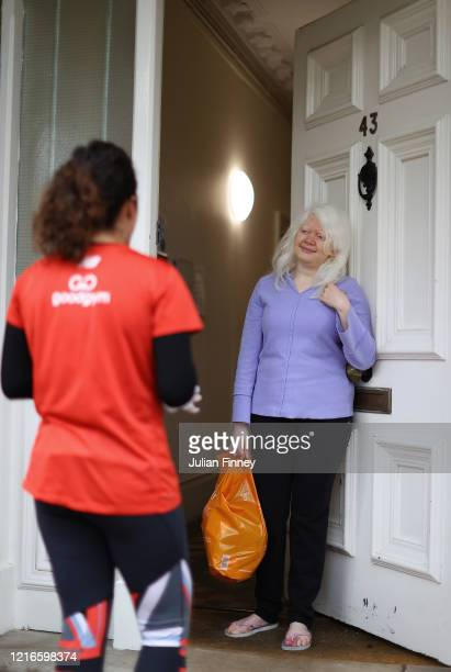 Remy a runner who volunteers with Goodgym delivers food from the supermarket to a woman who currently can't leave the house due to the COVID19...
