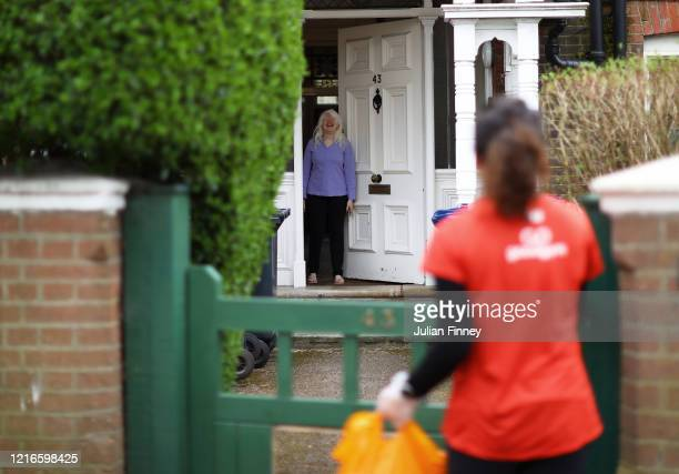 Remy, a runner who volunteers with Goodgym, delivers food from the supermarket to a woman who currently can't leave the house due to the COVID-19...